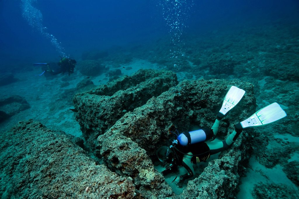 A diver and ancient stone coffins, sarcophagi, near the Five Islands, off the Cape Gelydonia, Adrasan, Lycia, Turkey, Mediterranean Sea : Stock Photo