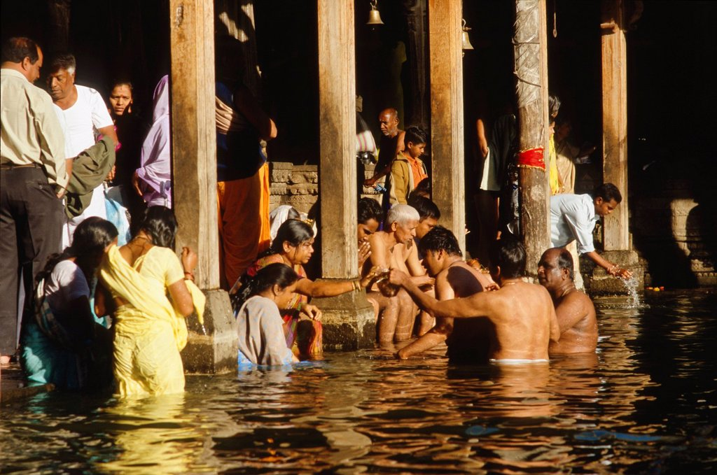 Stock Photo: 1848-585813 Pilgrims bathing in the source of the holy river Godavari to wash away sins, Trmbak, Maharashtra, India, Asia