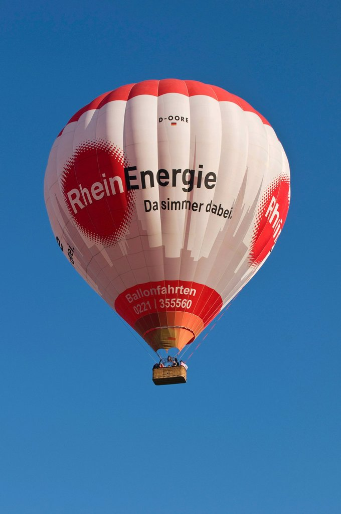 Stock Photo: 1848-585917 Captive ballon with Rheinenergie logo climbing against blue sky