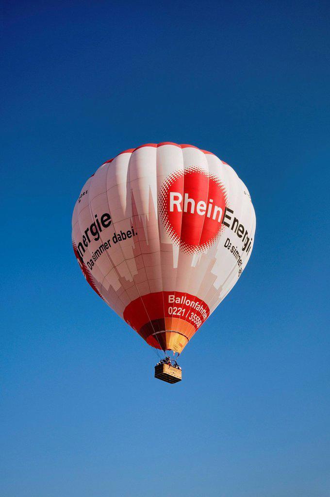 Stock Photo: 1848-585918 Captive ballon with Rheinenergie logo climbing against blue sky