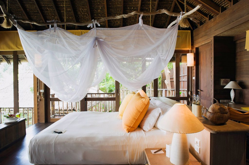 Stock Photo: 1848-586638 Bed in a luxury bungalow, luxury hotel, Six Senses Resort, Koh Yao Noi island, Phang Nga, Thailand, Southeast Asia, Asia