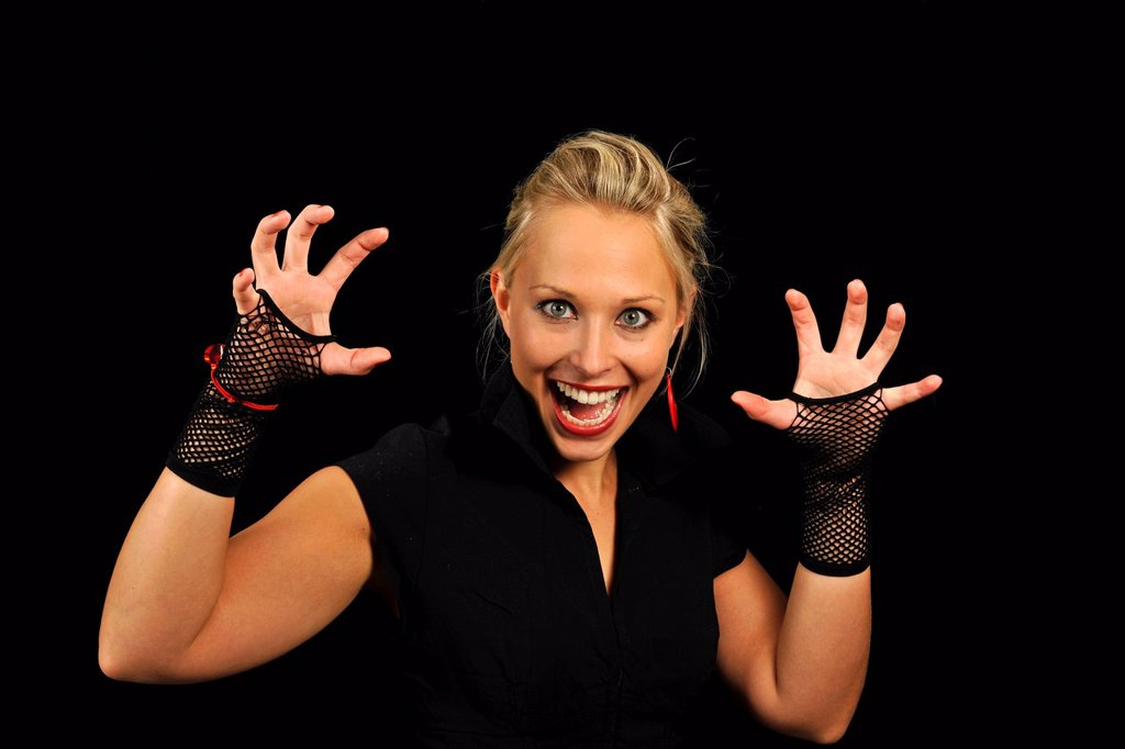 Stock Photo: 1848-586661 Young woman, vamp, showing her claws, Halloween