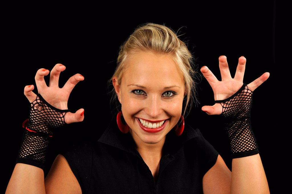 Stock Photo: 1848-586662 Young woman, vamp, showing her claws, Halloween