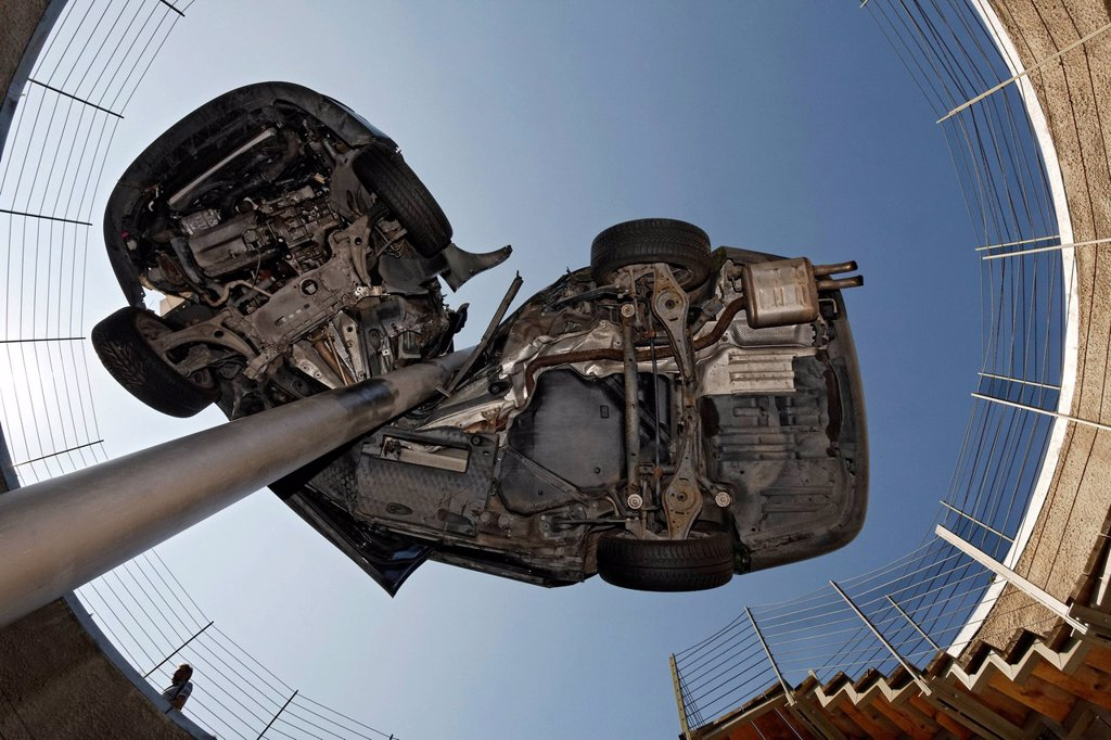 Demolished totalled car, impaled, sculpture ´´Reaktor´´ or reactor by Dirk Skreber, Skulpturenpark Koeln sculpture park, Cologne, North Rhine_Westphalia, Germany, Europe : Stock Photo