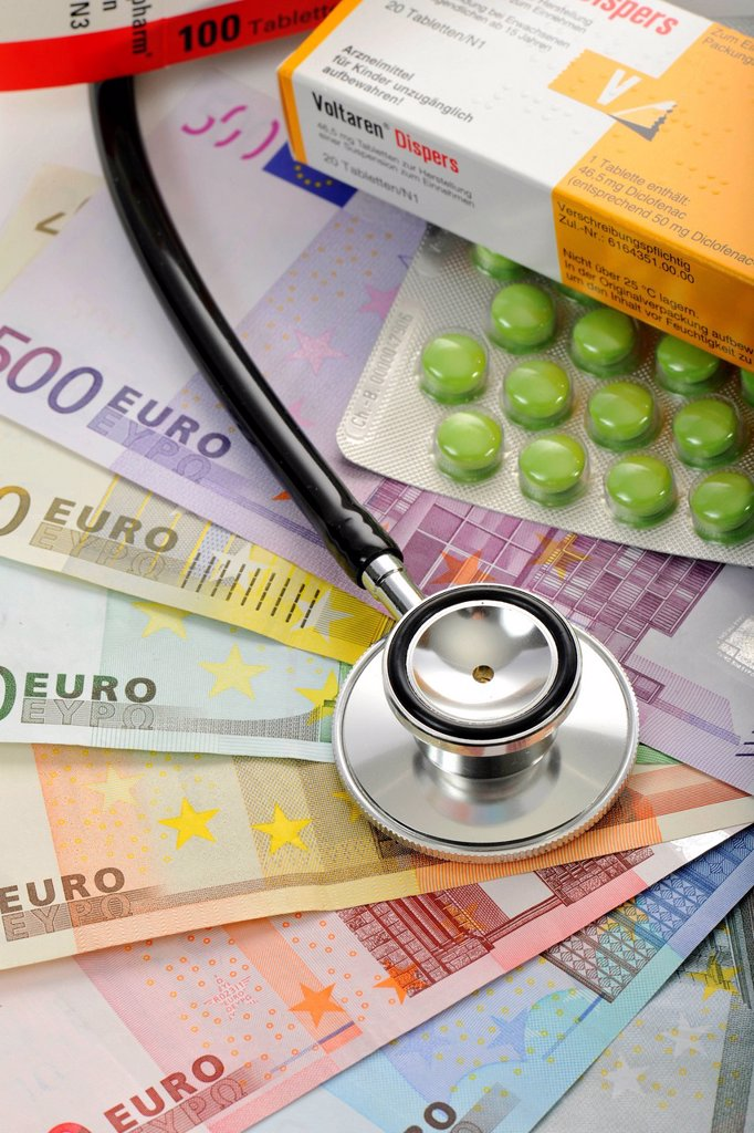 Stock Photo: 1848-587064 Pills and a stethoscope on a fan of euro banknotes, symbolic image of the sick euro, health care cost explosion, medical expenses