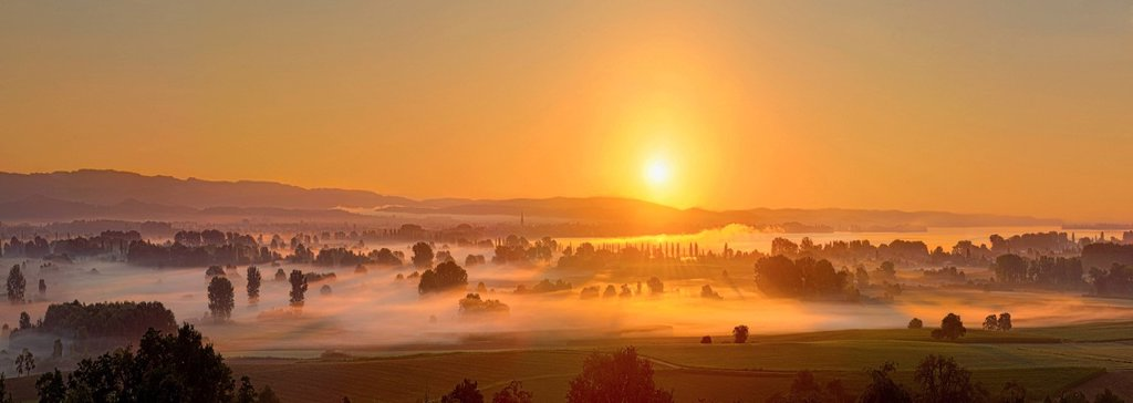 Sunrise over the Aachried area, left behind the city Radolfzell, Hegau area, Landkreis Konstanz county, Baden_Wuerttemberg, Germany, Europe : Stock Photo
