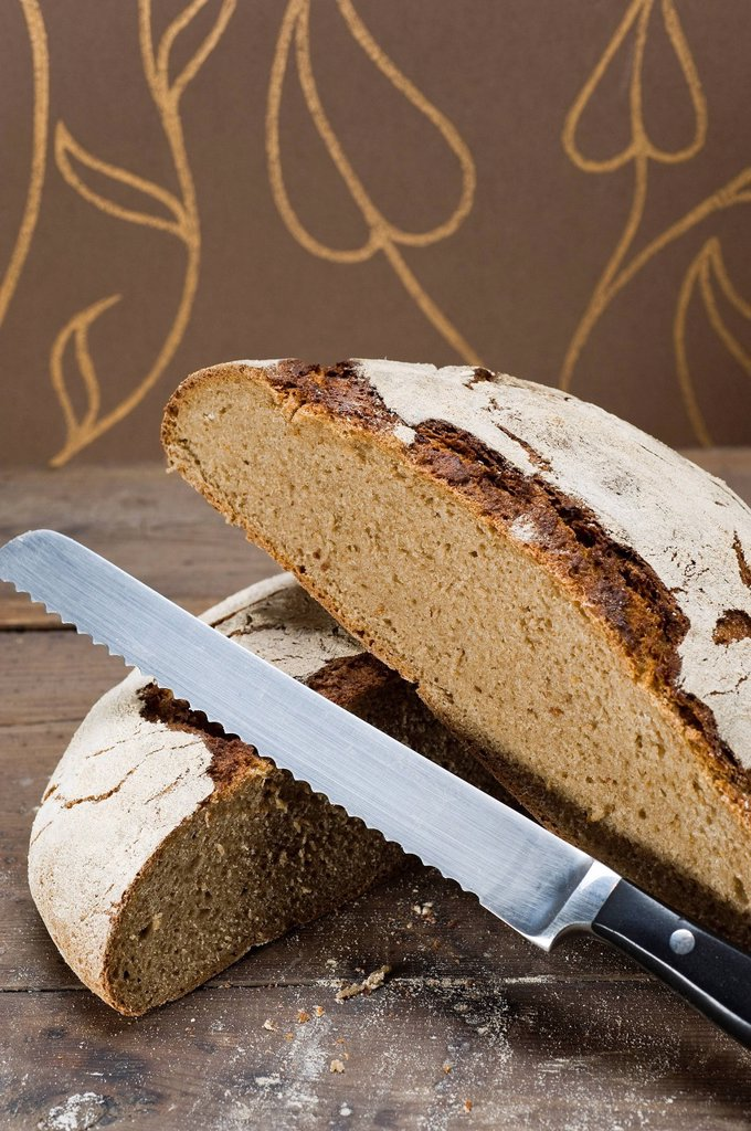 Stock Photo: 1848-588183 Home made sourdough bread, rye bread baked in a domestic oven, bread cut to show crumb
