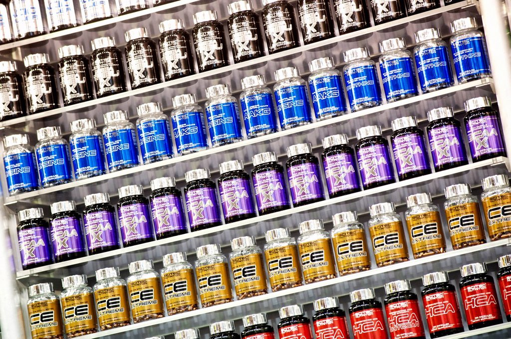 Stock Photo: 1848-588732 A shelf of nutritional supplements for muscle growth, bodybuilding, FIBO Power 2012 fitness fair, Essen, North Rhine_Westphalia, Germany, Europe