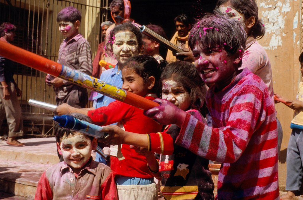 Stock Photo: 1848-589711 Kids spraying coloured water at the Holi festival, Vrindaban, Uttar Pradesh, India, Asia