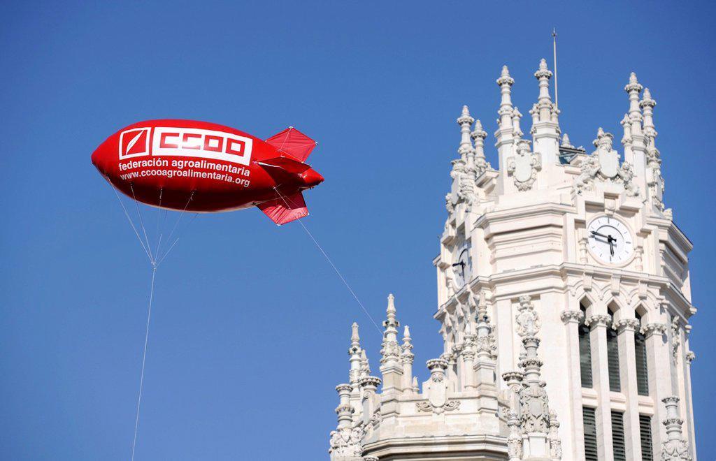 Stock Photo: 1848-589990 Gas_filled zeppelin during the general strike against cuts in social services in front of the Palacio Nuestra Señora de Correos or Palacio de Comunicaciones, post office, Madrid, Spain, Europe, PublicGround