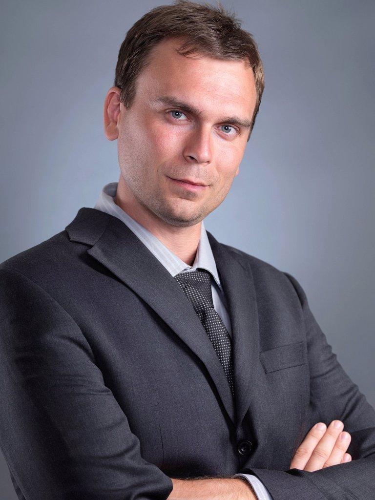 Businessman wearing a gray suit, portrait : Stock Photo
