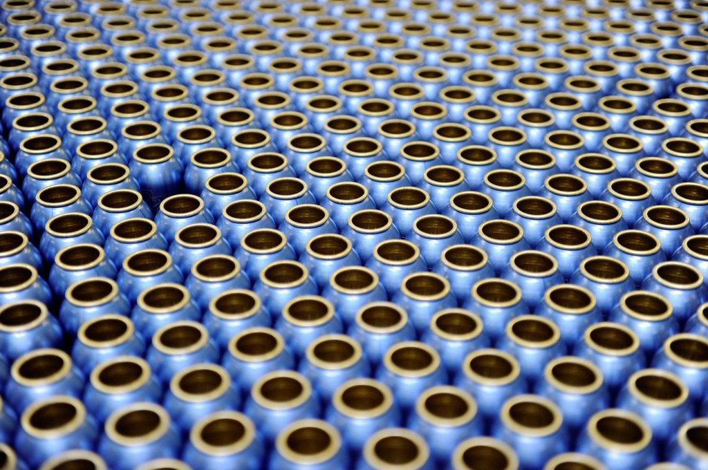 Empty aluminum bottles before being filled with deodorant, German cosmetics manufacturer : Stock Photo
