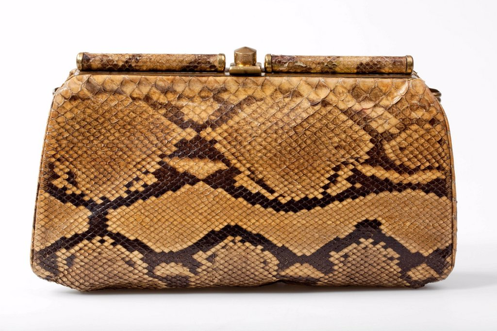 Vintage ladies´ handbag made of genuine snakeskin : Stock Photo