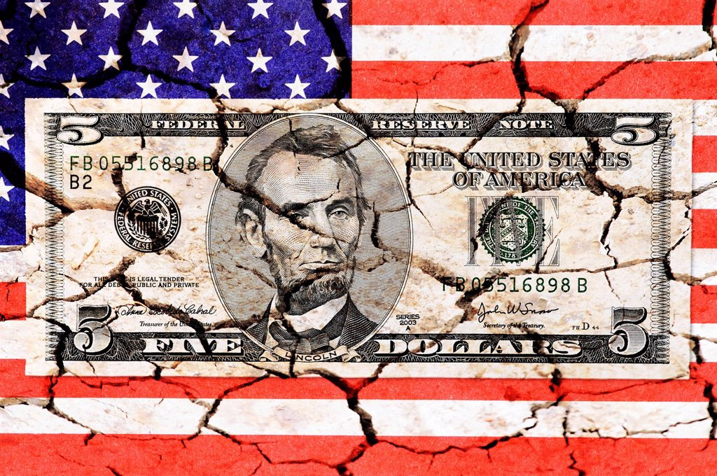 Five dollar bill on a US flag with cracks, symbolic images for US national debt : Stock Photo