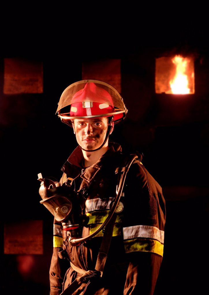 Stock Photo: 1848-591899 Firefighter in front of a burning building