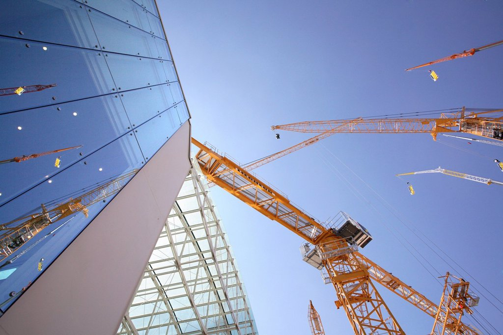Cranes, glass facade : Stock Photo