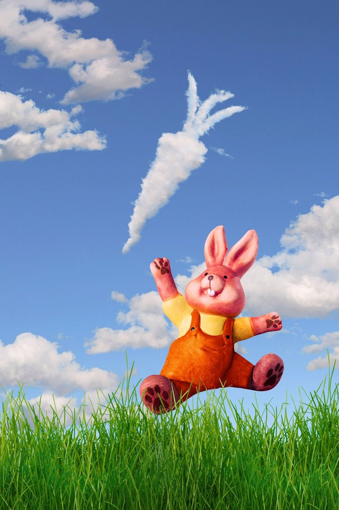 Bunny reaching for a cloud shaped like a carrot, illustration : Stock Photo