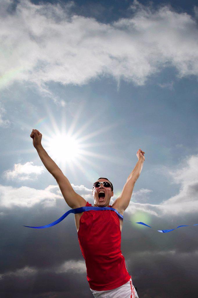 Runner, triumph, finish line, cheering : Stock Photo