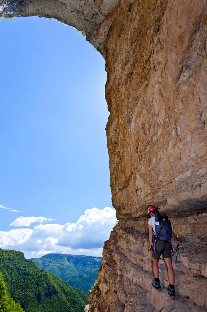 Stock Photo: 1848-594060 Climber on the Gerardo Sega fixed rope route on Monte Baldo above Avio, Lake Garda region, Trentino, Italy, Europe