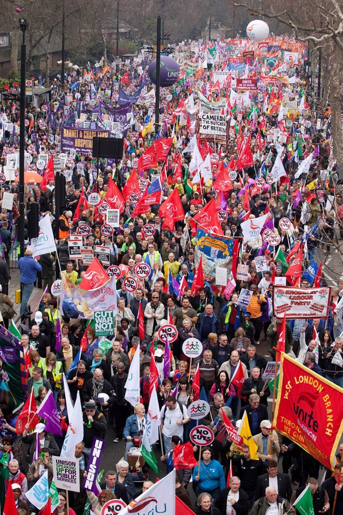 Trade Union members march at anti budget cuts demonstration in London, England, United Kingdom, Europe : Stock Photo