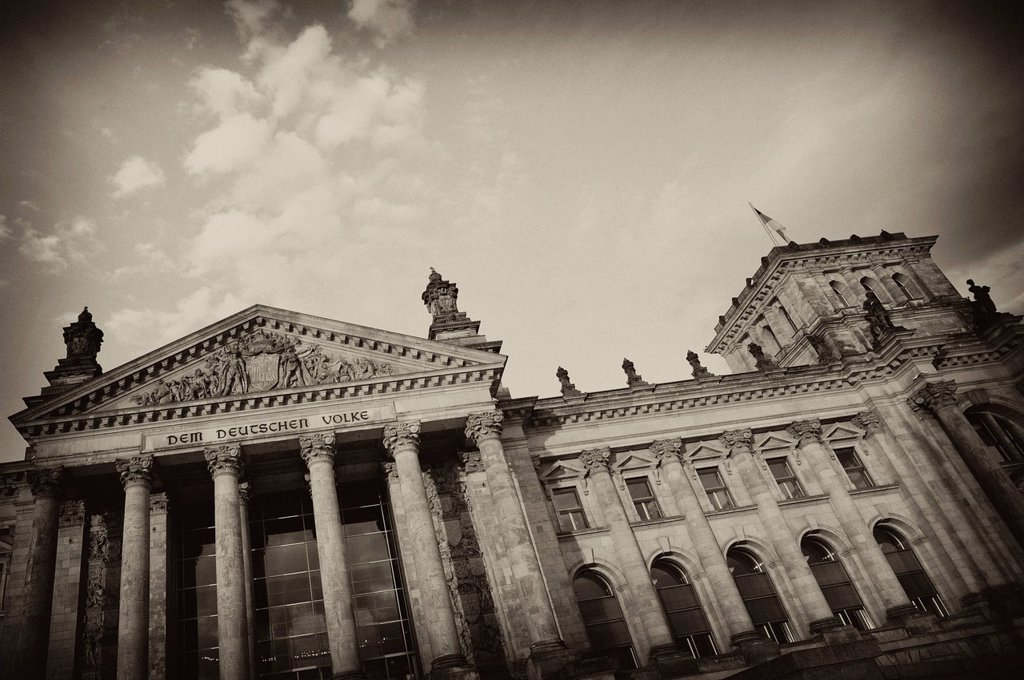 Black and white image, sepia_toned, Reichstag Building, German Parliament, with the inscription, Dem Deutschen Volke, German for To the German People, and a relief in the tympanum over the main portal, Government District, district of Tiergarten, Berlin,. Black and white image, sepia_toned, Reichstag Building, German Parliament, with the inscription, Dem Deutschen Volke, German for To the German People, and a relief in the tympanum over the main portal, Government District, district of Tiergarte : Stock Photo