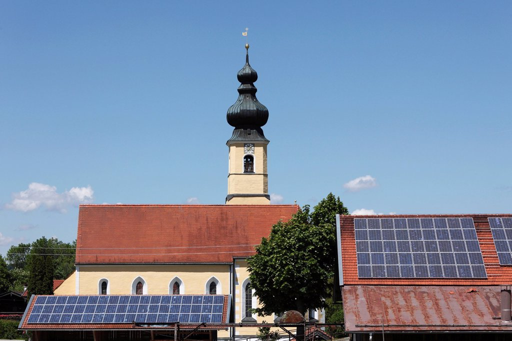 Stock Photo: 1848-596528 Church of the Nativity behind barnroofs with solar panels, Frauenried, Irschenberg district, Upper Bavaria, Bavaria, Germany, Europe