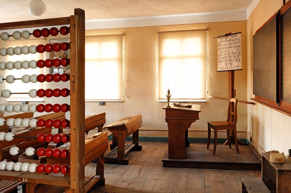 Classroom with teacher´s desk and ABC board, on the left an abacus, 1935, school building from Pfaffenhofen, built in 1801, Franconian open_air museum, Eisweiherweg 1, Bad Windsheim, Middle Franconia, Bavaria, Germany, Europe : Stock Photo