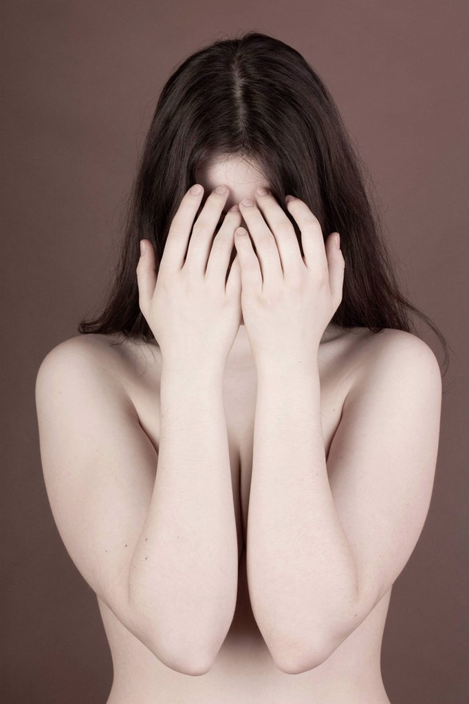 Stock Photo: 1848-597801 Young woman, upper body, naked, with her face hidden