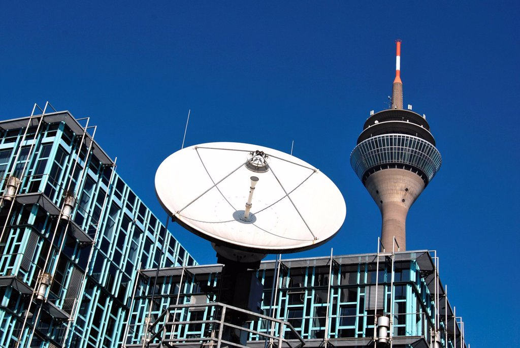 Stock Photo: 1848-598854 TV satellite transmission system in front of the building of the WDR local tv studio, behind the Rheinturm radio and tv tower, Duesseldorf, North Rhine_Westphalia, Germany, Europe