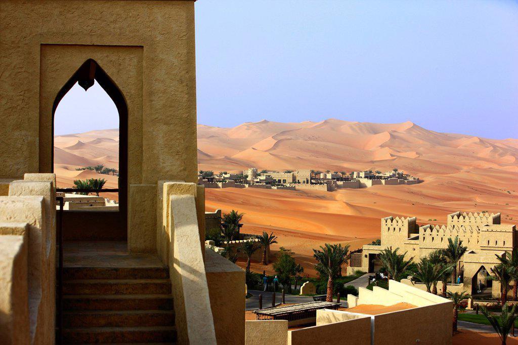 Anantara Qasr Al Sarab luxury desert hotel, built in the style of a kasbah, hotel resort, amidst huge sand dunes, near Liwa Oasis in the Empty Quarter Rub Al Khali sand desert, Abu Dhabi, United Arab Emirates, Middle East : Stock Photo