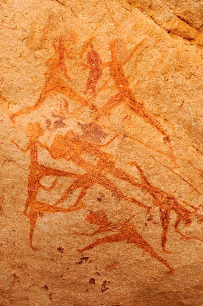 Hunting scene, neolithic rock art of the Tadrart, Tassili n´Ajjer National Park, Unesco World Heritage Site, Algeria, Sahara, North Africa : Stock Photo
