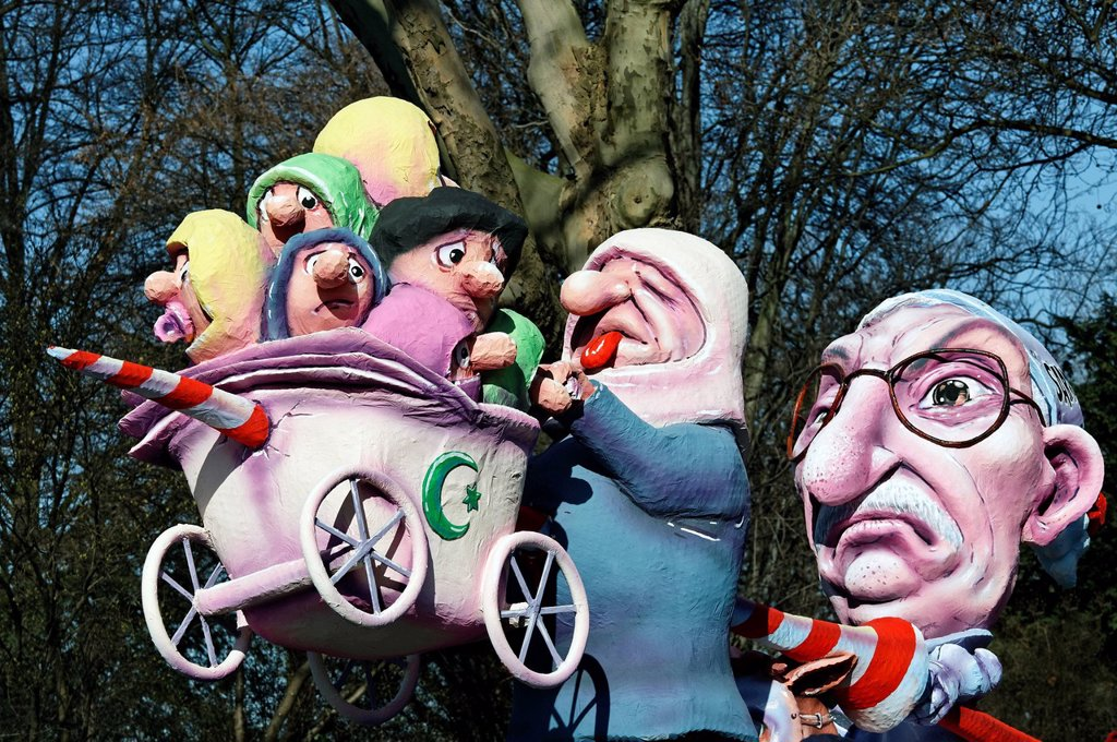 Stock Photo: 1848-599677 Thilo Sarrazin, impaling Turkish migrants, paper_mache figures, satirical themed parade float at the Rosenmontagszug Carnival Parade 2011, Duesseldorf, North Rhine_Westphalia, Germany, Europe