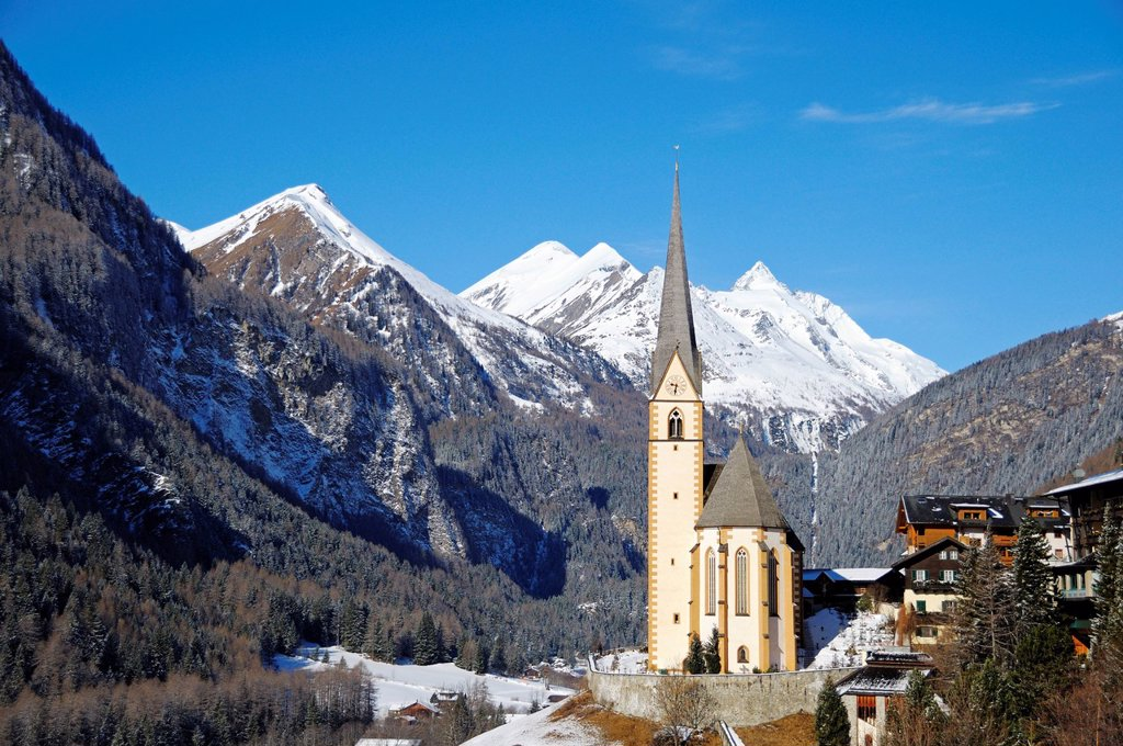 Stock Photo: 1848-600242 Pilgrimage Church of St. Vinzenz in winter, in front of Grossglockner Mountain, Heiligenblut in Moelltal Valley, National Park Hohe Tauern, Carinthia, Austria, Europe
