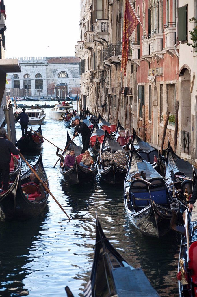 Gondolas on a canal, Venice, Veneto region, Italy, Europe : Stock Photo