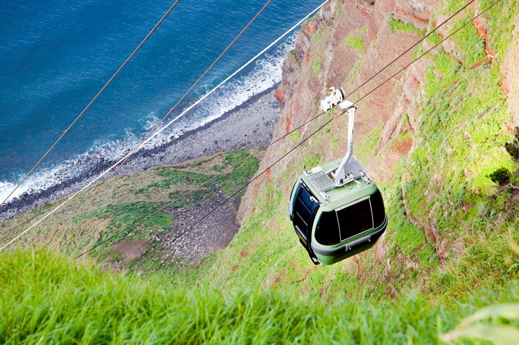 Cable car to the fields and plantations on the rock cliffs of the Atlantic coast, at Achadas da Cruz, Madeira, Portugal, Europe : Stock Photo