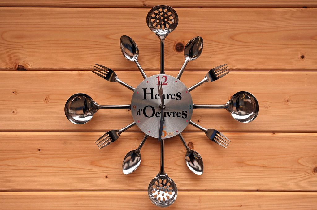 Stock Photo: 1848-602509 Wall clock made of cutlery on a wooden wall