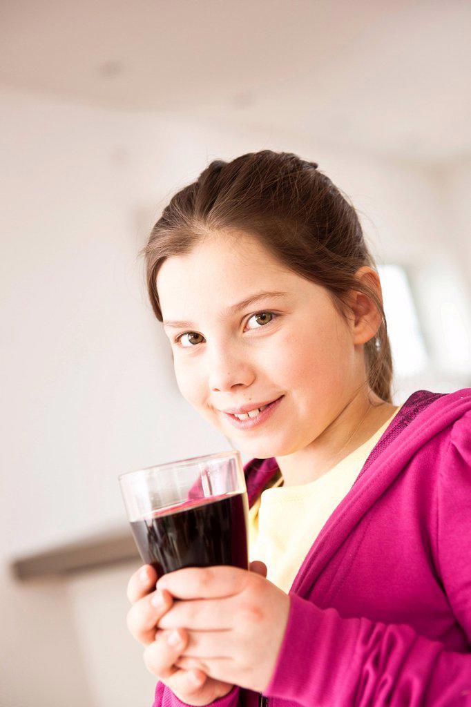 Girl drinking coca cola : Stock Photo