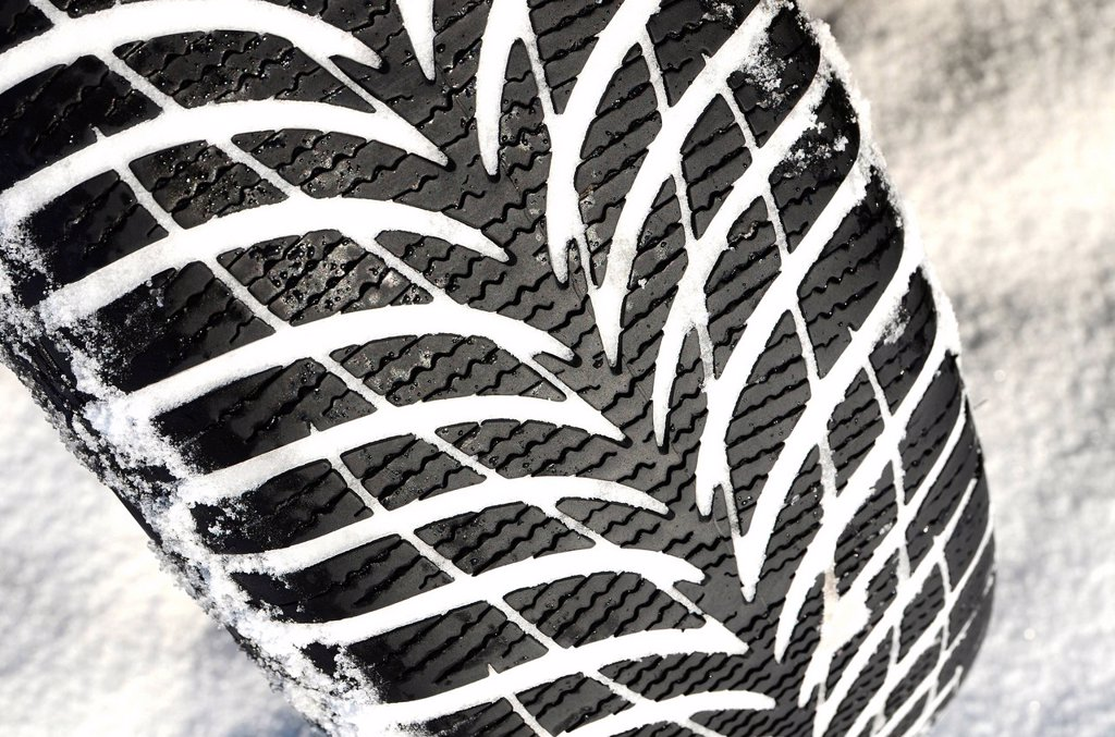 Snow tyre, winter tyre : Stock Photo