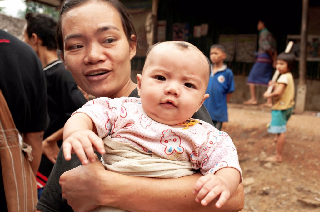 Stock Photo: 1848-604268 Karen mother and her baby in the Mae La refugee camp, Tak province, Thailand, Asia