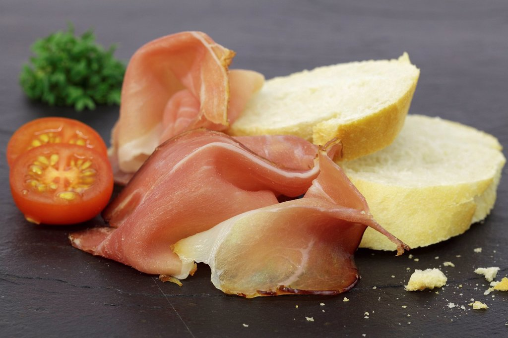 Black Forest ham with slices of baguette : Stock Photo