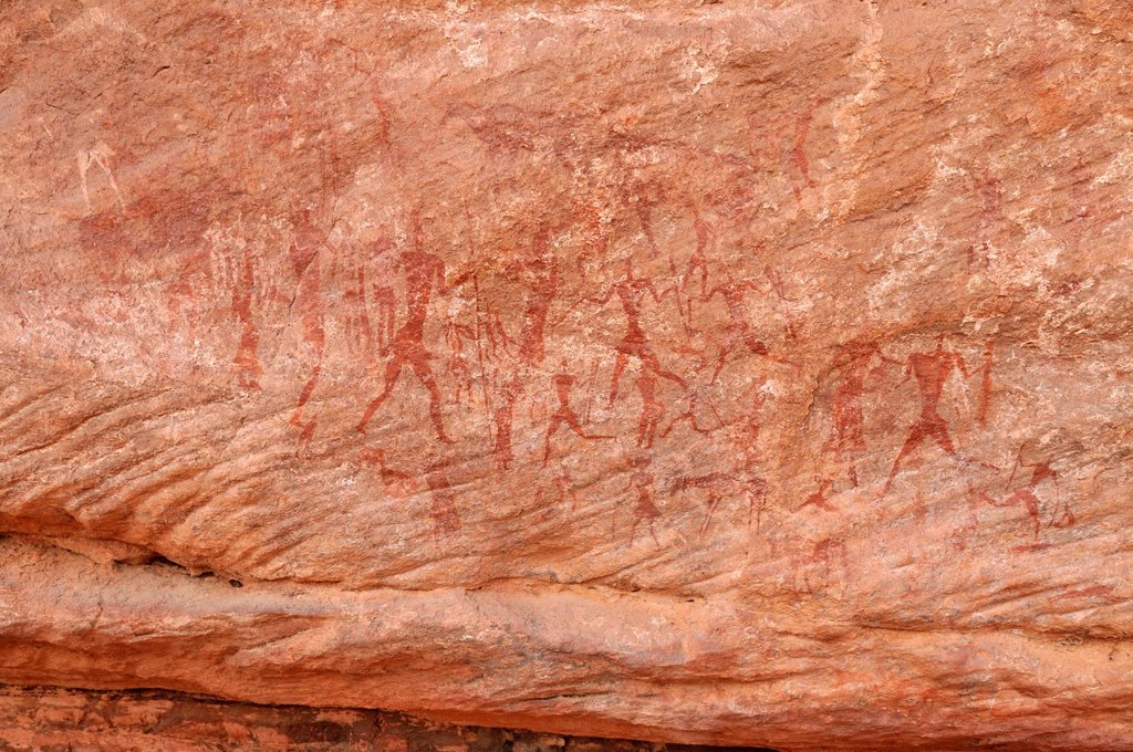Painted people, neolithic rockart of the Acacus Mountains or Tadrart Acacus range, Tassili n´Ajjer National Park, Unesco World Heritage Site, Algeria, Sahara, North Africa : Stock Photo