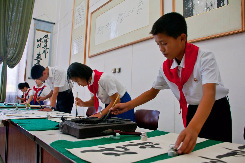 Selected children practicing calligraphy in the Children´s Palace, Pyongyang, North Korea, Asia : Stock Photo