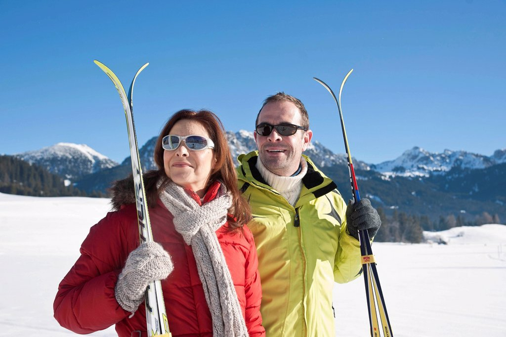 Couple with cross_country skis in the mountains : Stock Photo