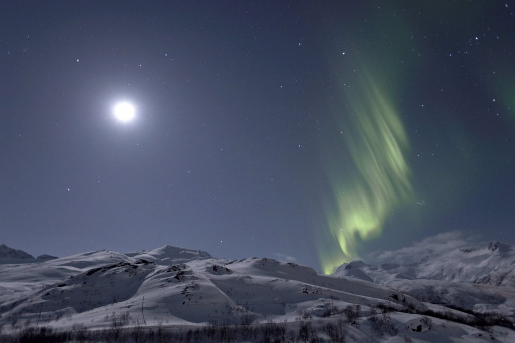 Stock Photo: 1848-606211 Polar lights Aurora borealis, and the moon above Sildpollheia mountain near Sildpollneset, Austnesfjorden, Austvagoya, Lofoten, Norway, Europe