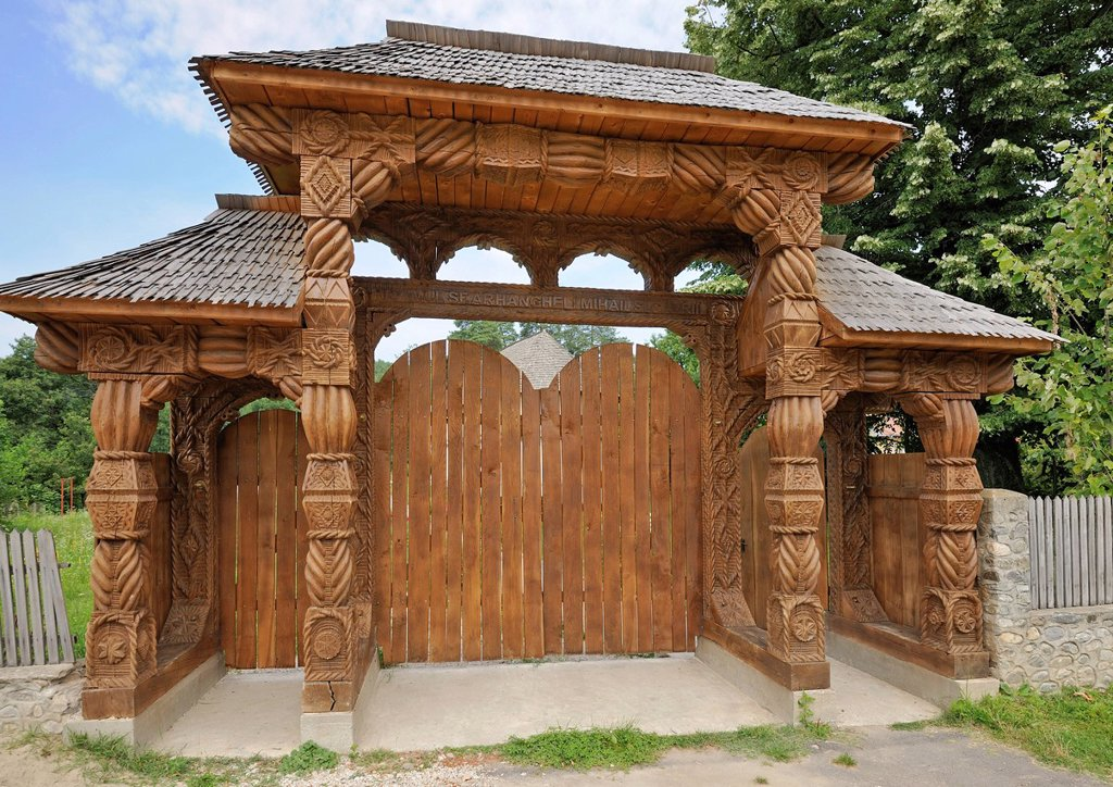 Stock Photo: 1848-606499 Carved entrance gate next to a small church, Horezu, Oltenia region, Lesser Wallachia, Romania, Europe