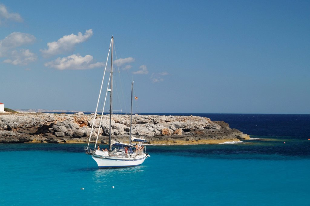 Bay with a boat near Son Xoriguer, Menorca, Spain, Europe : Stock Photo