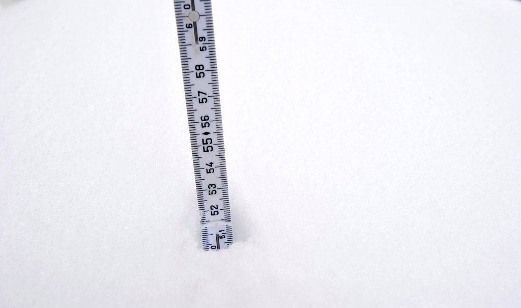 Yard stick in the snow measuring the snow depth : Stock Photo