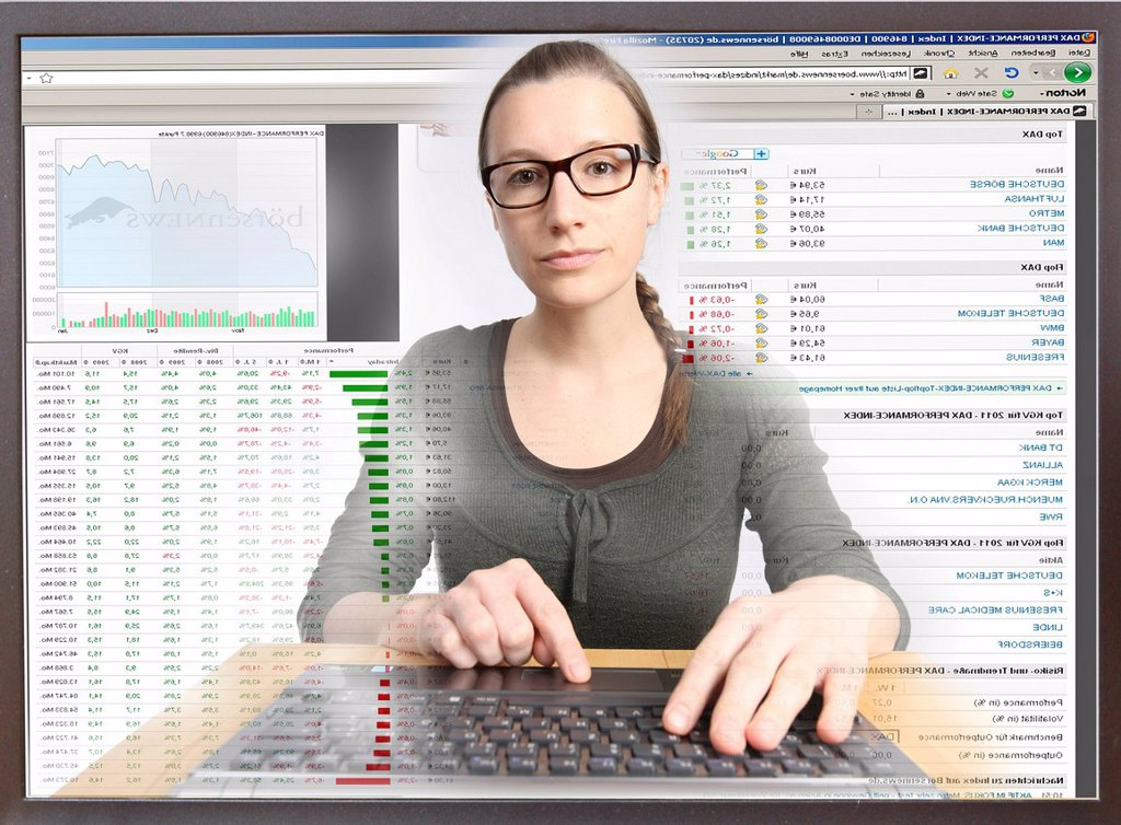 Stock Photo: 1848-607871 Young woman sitting at a computer surfing the Internet, viewing a page with stock market information, view from within the computer, symbolic image