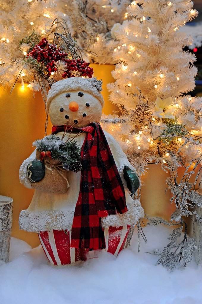Christmas decorations, snowman in front of a Christmas tree : Stock Photo