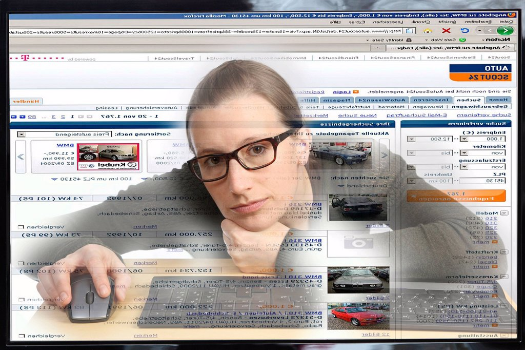 Stock Photo: 1848-608480 Young woman sitting at a computer surfing the Internet, viewing a page for buying and selling vehicles, autoscout24.de, view from within the computer, symbolic image